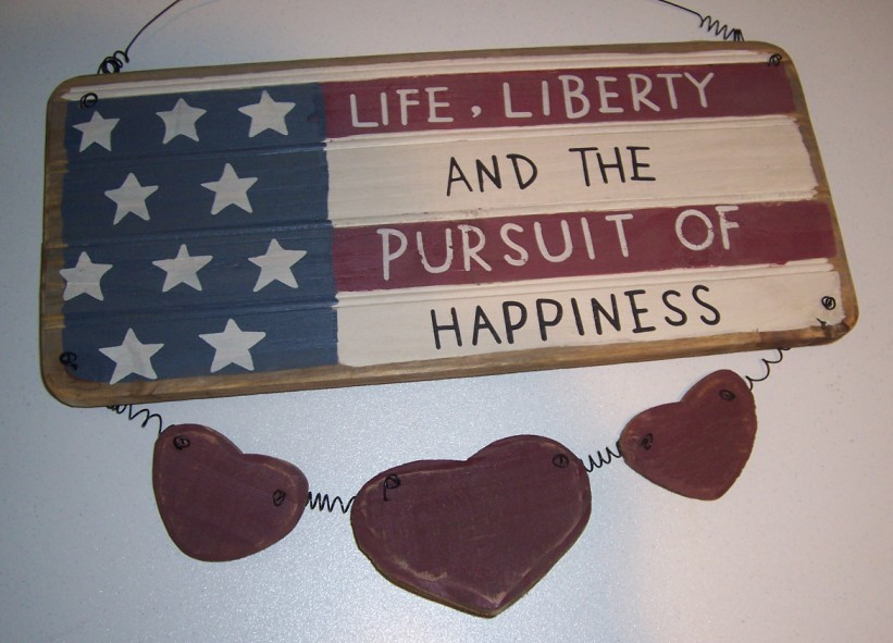 "Wood Sign with the Words ""Life, Liberty and The Pursuit of Happiness"""